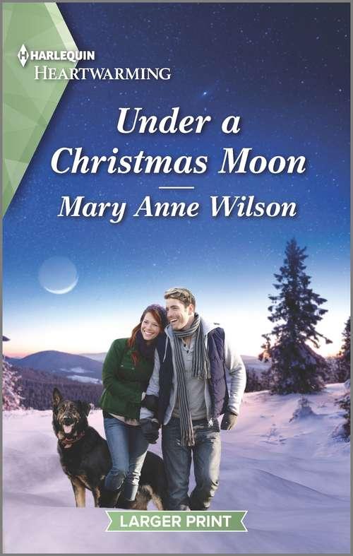 Under a Christmas Moon: A Clean Romance (Eclipse Ridge Ranch #1)