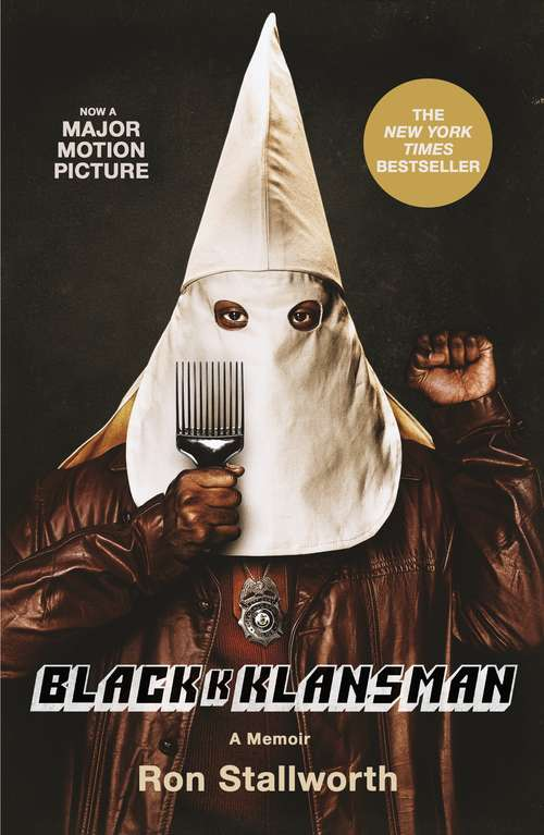 Black Klansman, a black man wearing a Ku Klux Klan hood, holding an afro pick in one hand and makes a fist in the other hand